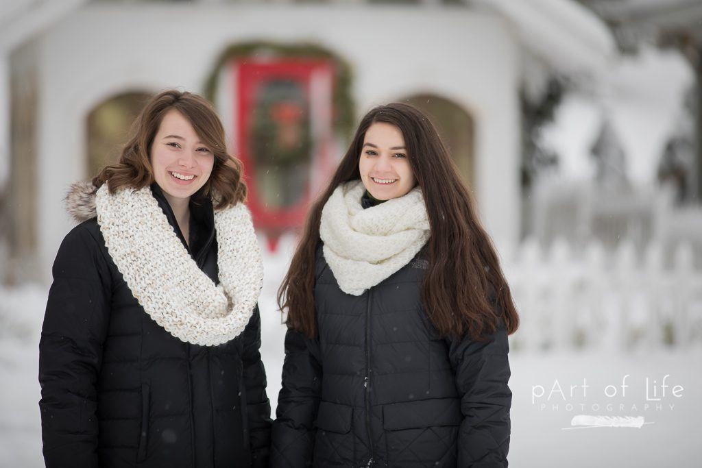 friends at snowy cottage for senior session