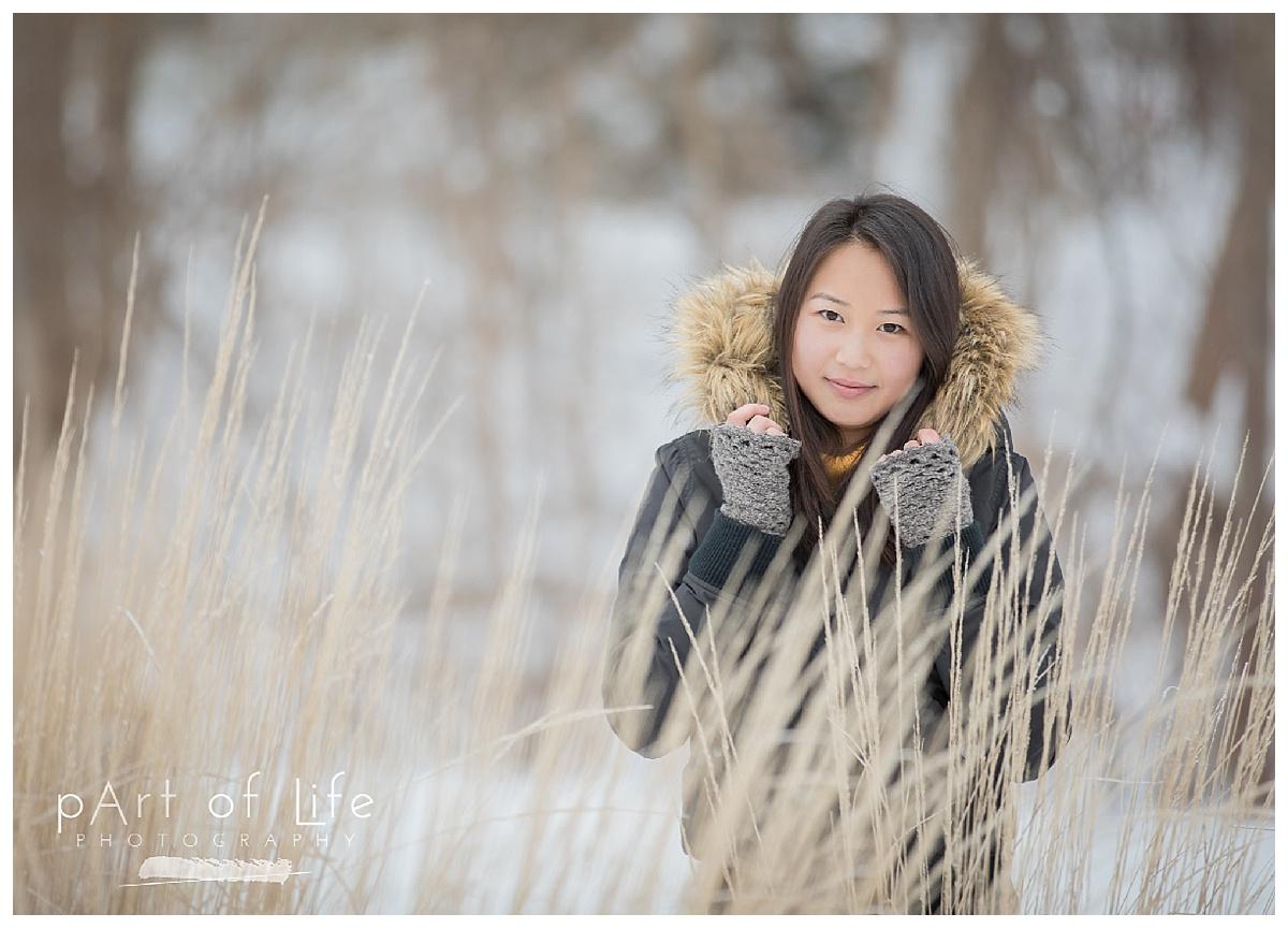 Jordan hiding in snowy grasses in Rochester Park