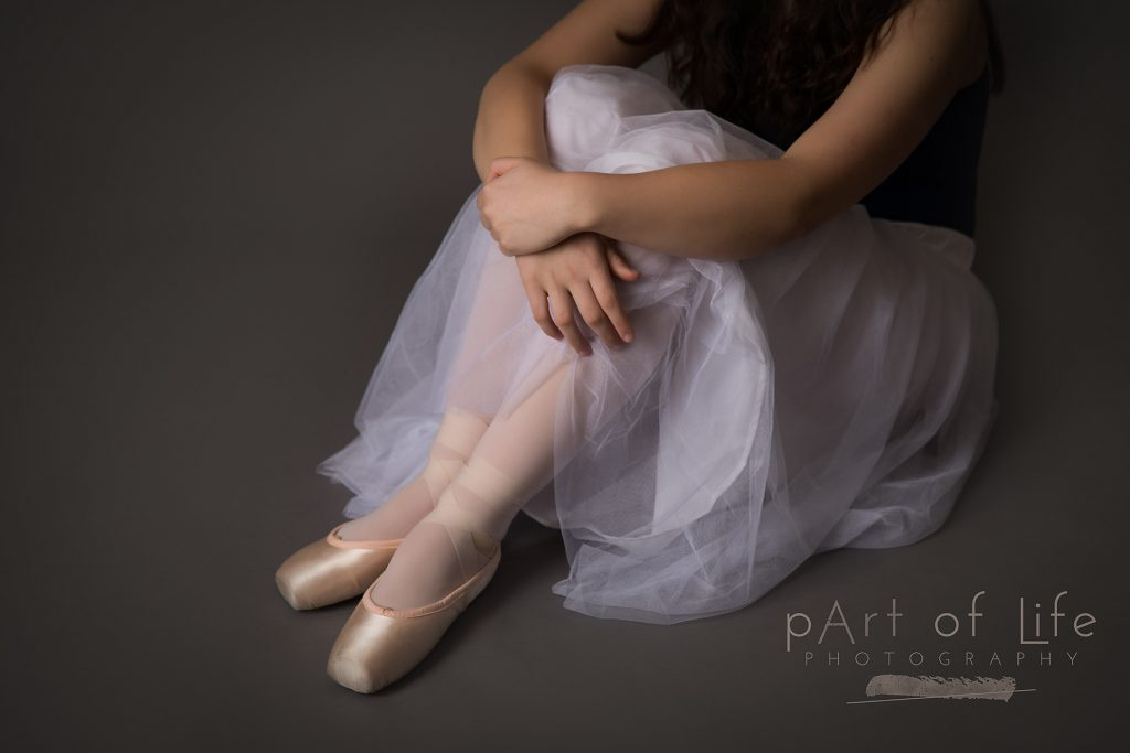 quiet moment with ballet dancer in pointe shoes
