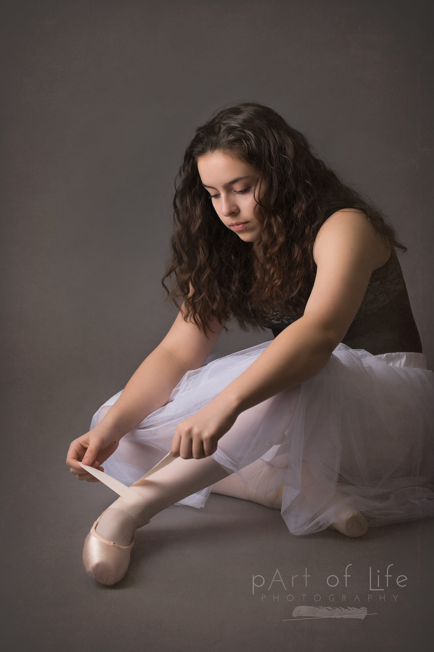 Teen with ballet pointe shoes