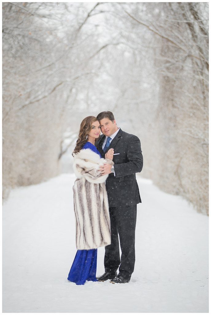 romantic engagement session in the snow