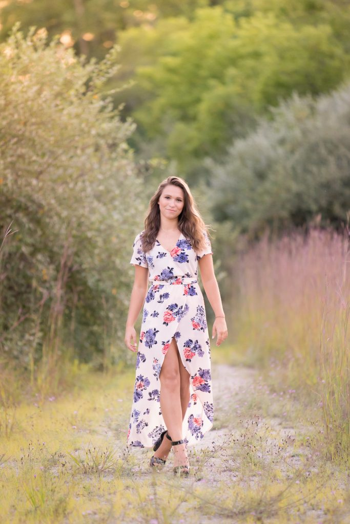 Senior in gorgeous dress in rochester michigan meadow
